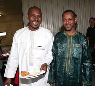 Oumar Gueye & Idrissa Ba enjoy the delicious food on offer