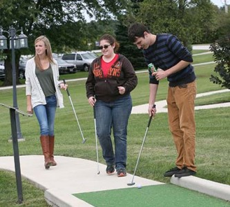 Elizabeth Horton, Renee Leber and Matt Hedrick enjoy a round of miniature golf
