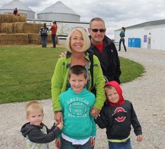 Vicki and Scott Peltier enjoy the picnic with their grandchildren