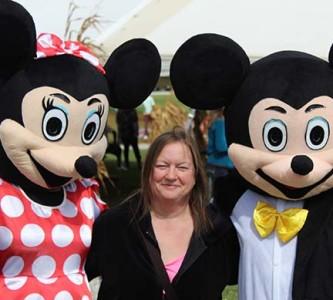 Tarra Haidara shares a hug with Minnie and Micky Mouse