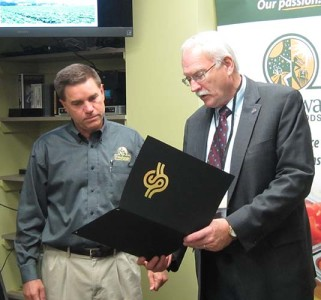 Devon Beer receives a proclamation from Sidney Mayor Mike Barhorst