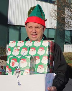 Sam Schlagetter loads presents for delivery to local families