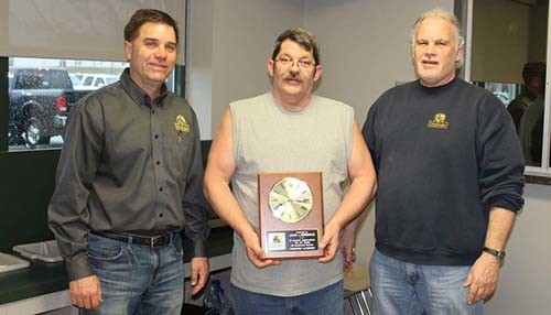 John Lawrence receives service award from Devon Beer and Dan Stegall